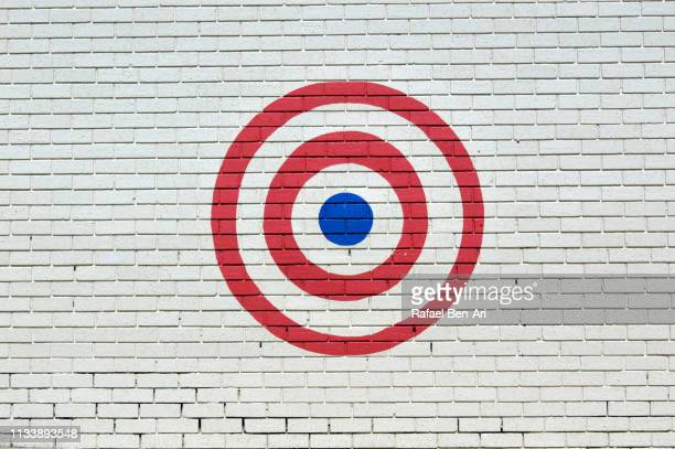 Target sign on a brick wall