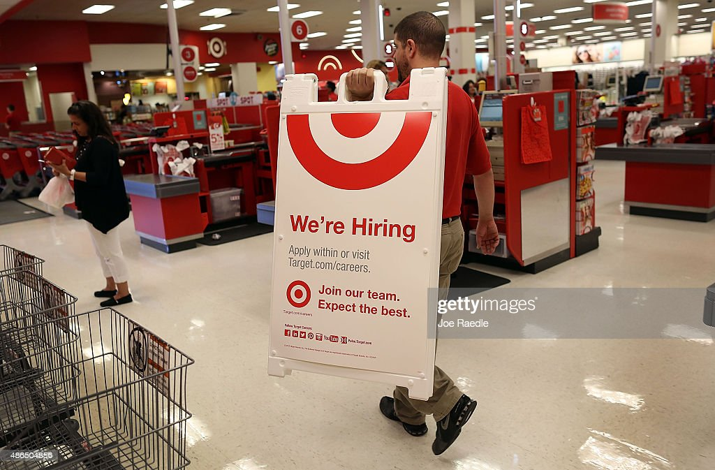 Target store manager, Javier Ortega, prepares to put up a we're hiring sign outside the store on September 4, 2015 in Miami, Florida. The U.S. Bureau of Labor Statistics released the August jobs report that shows that the economy created just 173,000 new jobs last month. But the unemployment rate dipped to 5.1%, the lowest since April 2008,
