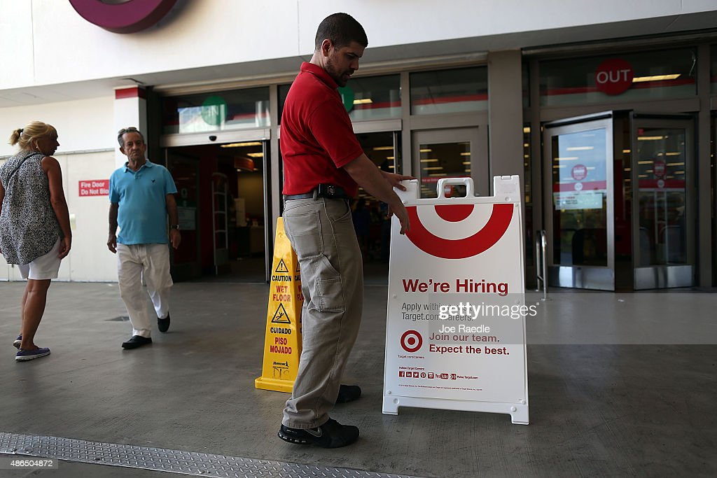Target store manager, Javier Ortega, puts up a we're hiring sign outside the store store on September 4, 2015 in Miami, Florida. The U.S. Bureau of Labor Statistics released the August jobs report that shows that the economy created just 173,000 new jobs last month. But the unemployment rate dipped to 5.1%, the lowest since April 2008,