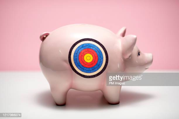 targeted piggy bank - sports target stock pictures, royalty-free photos & images