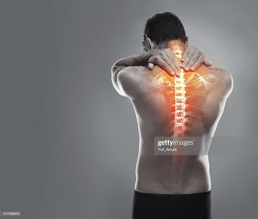 Targeting dolor de espalda : Foto de stock