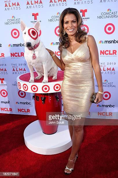 Target's bull terrier mascot Bullseye and actress Lisa Vidal celebrate the 2013 NCLR ALMA Awards sponsored by Target at Pasadena Civic Auditorium on...