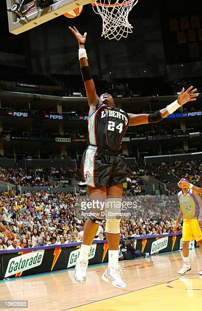 Tari Phillips of the New York Liberty goes in for a layup against the Los Angeles Sparks during Game 2 of the 2002 WNBA Finals on August 31 2002 at...