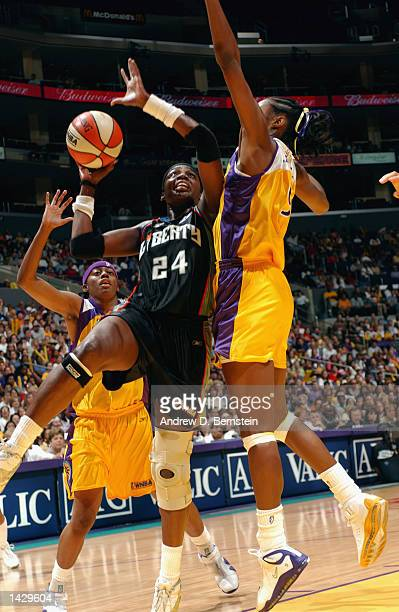 Tari Phillips of the New York Liberty is defended by Lisa Leslie of the Los Angeles Sparks during Game two of the 2002 WNBA Finals on August 31, 2002...