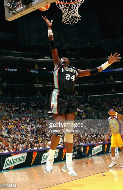 Tari Phillips of the New York Liberty lays the ball up during Game two of the 2002 WNBA Finals against the Los Angeles Sparks on August 31, 2002 at...