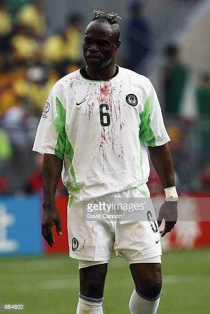 Taribo West of Nigeria after a clash of heads during the FIFA World Cup Finals 2002 Group F match between Sweden and Nigeria played at the Kobe Wing...