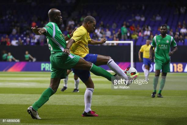 Taribo West tries to tackle Djalminha during the Star Sixe's match between Brazil and Nigeria at The O2 Arena on July 15 2017 in London England