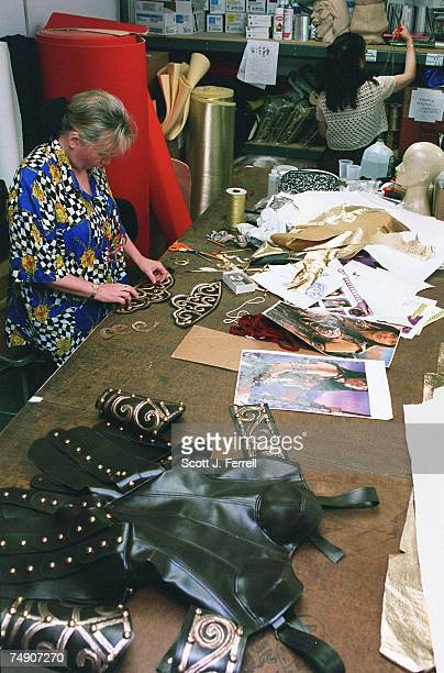 TARIFFSCostume designer Karin Batty works on a vinyl version of the outfit worn by the main character of the popular television series 'Xena' at...