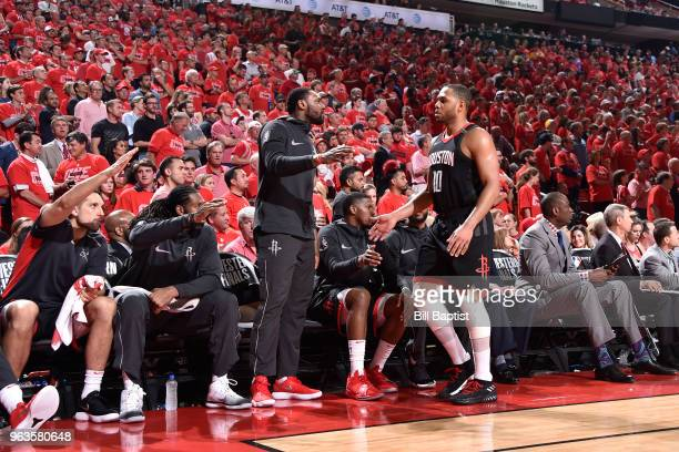 Tarik Black and Eric Gordon of the Houston Rockets high five in Game Seven of the Western Conference Finals against the Golden State Warriors during...