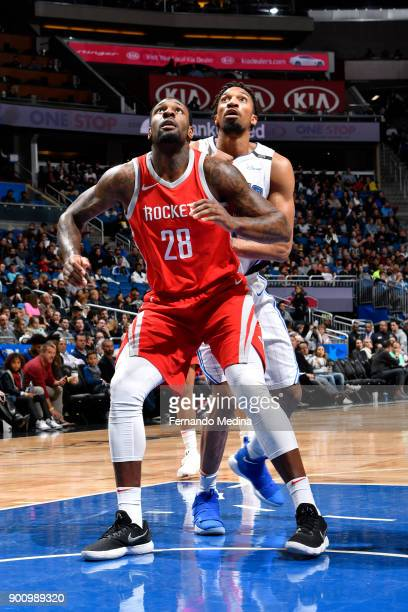 Tarik Black of the Houston Rockets and Khem Birch of the Orlando Magic look react to a play during the game on January 3 2018 at the Amway Center in...