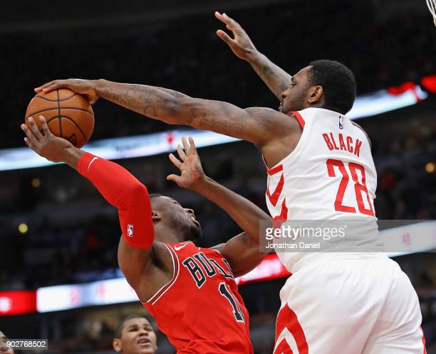 Tarik Black of the Houston Rockets blocks a shot by David Nwaba of the Chicago Bulls at the United Center on January 8 2018 in Chicago Illinois The...