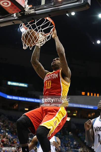 Tarik Black of the Houston Rockets dunks against the Minnesota Timberwolves on December 5 2014 at Target Center in Minneapolis Minnesota NOTE TO USER...