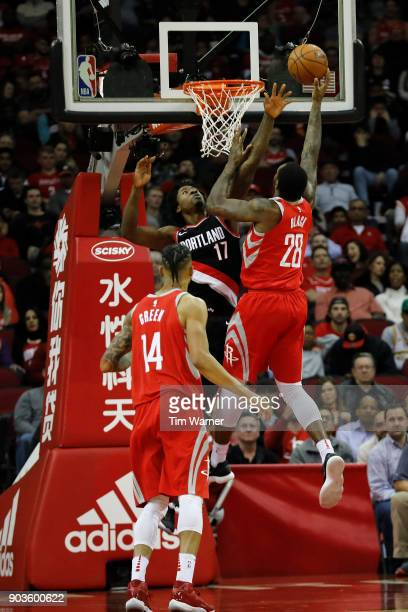 Tarik Black of the Houston Rockets goes up for a lay up defended by Ed Davis of the Portland Trail Blazers in the first half at Toyota Center on...