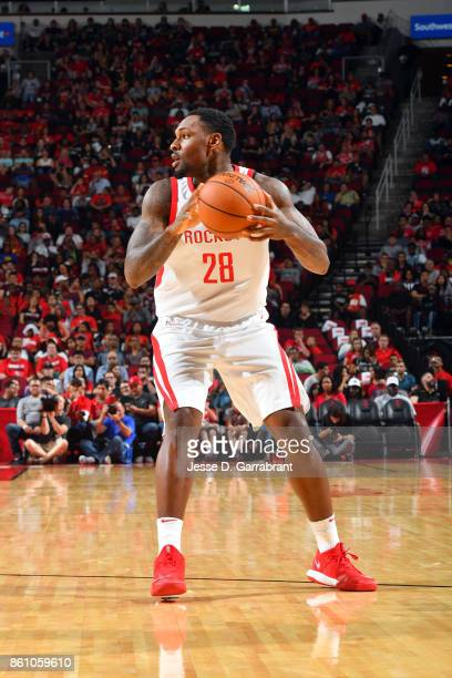 Tarik Black of the Houston Rockets handles the ball during the preseason game against the San Antonio Spurs on October 13 2017 at Toyota Center in...