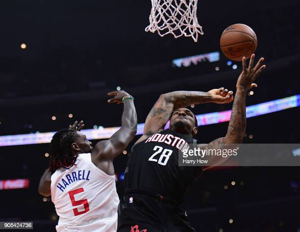 Tarik Black of the Houston Rockets is fouled by Montrezl Harrell of the LA Clippers during the first half at Staples Center on January 15 2018 in Los...
