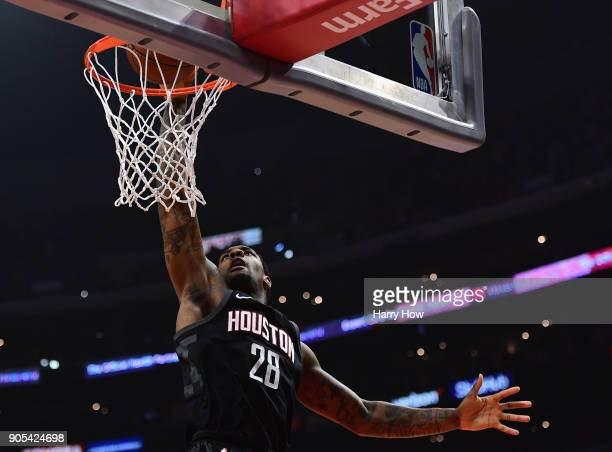 Tarik Black of the Houston Rockets scores on a dunk during the first half against the LA Clippers at Staples Center on January 15 2018 in Los Angeles...