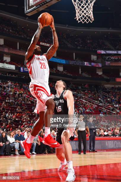 Tarik Black of the Houston Rockets shoots the ball during the preseason game against the San Antonio Spurs on October 13 2017 at Toyota Center in...