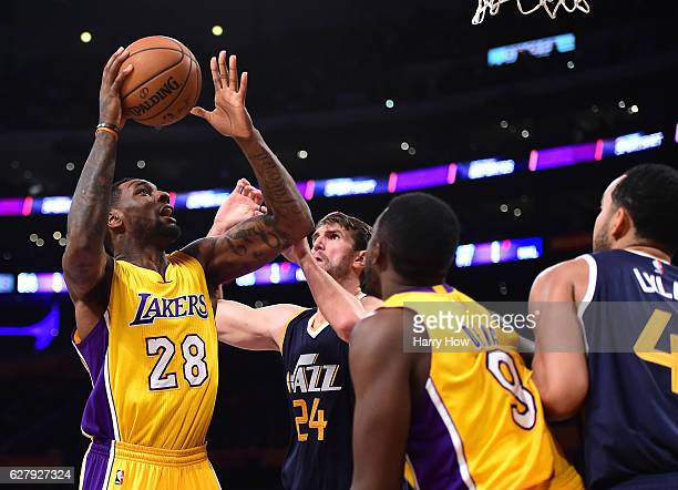 Tarik Black of the Los Angeles Lakers attempts a shot on Jeff Withey of the Utah Jazz during the first half at Staples Center on December 5 2016 in...