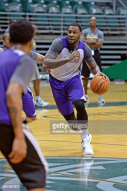 ae7b9bdf0 Tarik Black of the Los Angeles Lakers drives to the basket during training  camp at the