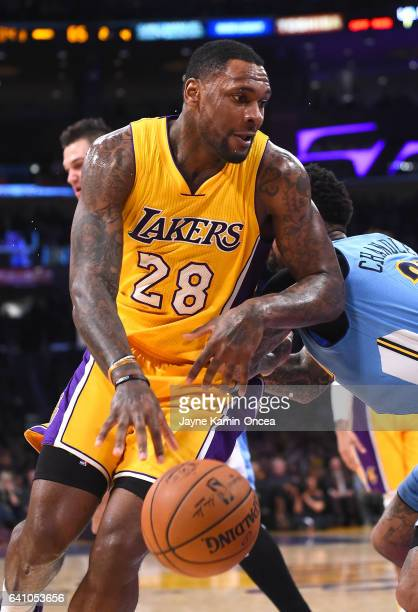 Tarik Black of the Los Angeles Lakers drives to the basket during the game against the Denver Nuggets at Staples Center on January 31 2017 in Los...