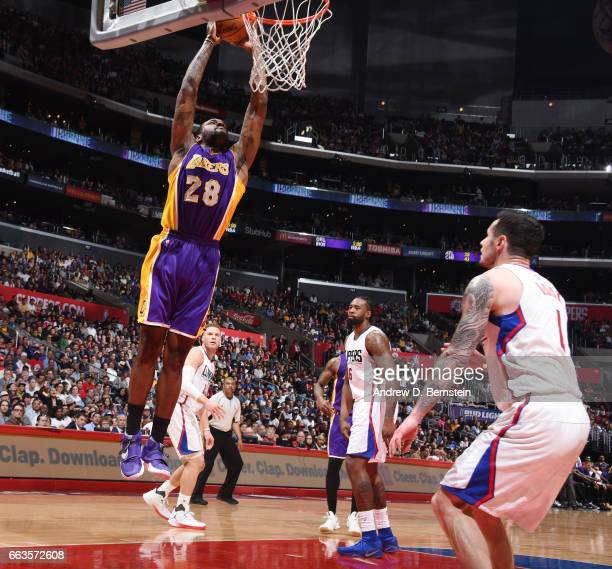 Tarik Black of the Los Angeles Lakers dunks against the LA Clippers during the game on April 1 2017 at STAPLES Center in Los Angeles California NOTE...