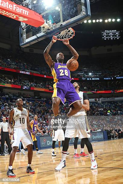 Tarik Black of the Los Angeles Lakers dunks the ball against the New Orleans Pelicans during the game on November 29 2016 at Smoothie King Center in...
