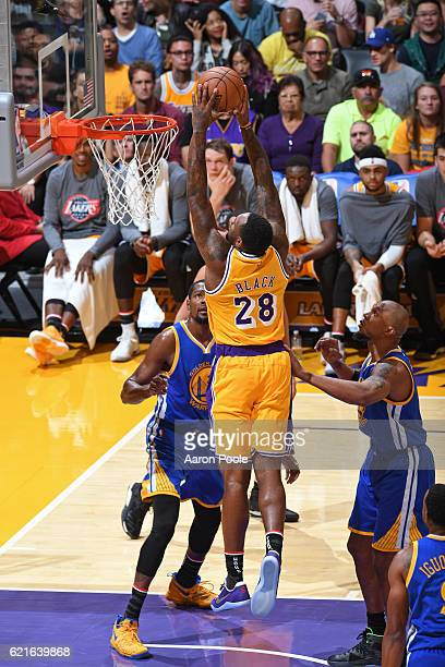 Tarik Black of the Los Angeles Lakers dunks the ball against the Golden State Warriors on November 4 2016 at STAPLES Center in Los Angeles California...