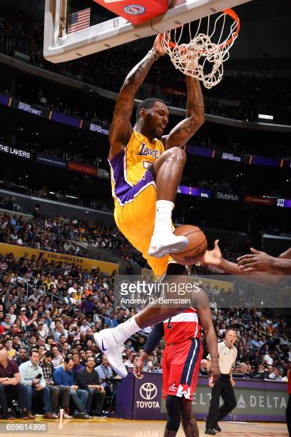 Tarik Black of the Los Angeles Lakers dunks the ball during the game against the Washington Wizards on March 28 2017 at STAPLES Center in Los Angeles...