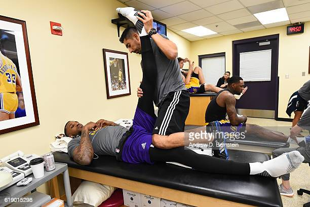 Tarik Black of the Los Angeles Lakers gets treatment from trainer Marco Nunez before the game against the Houston Rockets on October 26 2016 at...
