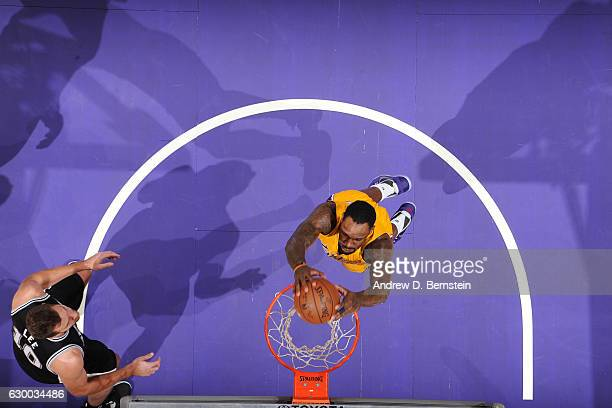 Tarik Black of the Los Angeles Lakers goes up for a dunk against the San Antonio Spurs on November 18 2016 at STAPLES Center in Los Angeles...