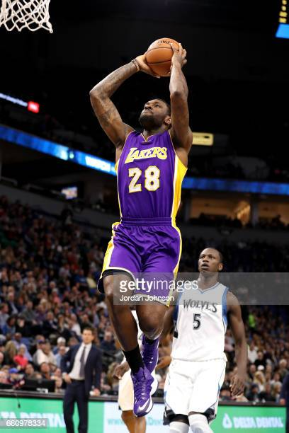 Tarik Black of the Los Angeles Lakers goes up for a dunk against the Minnesota Timberwolves on March 30 2017 at Target Center in Minneapolis...