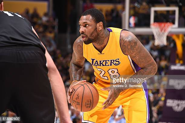 Tarik Black of the Los Angeles Lakers handles the ball against the Brooklyn Nets on March 1 2016 at STAPLES Center in Los Angeles California NOTE TO...