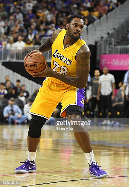 Tarik Black of the Los Angeles Lakers looks to pass against the Golden State Warriors during their preseason game at TMobile Arena on October 15 2016...