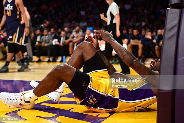 Tarik Black of the Los Angeles Lakers reacts as he falls to the ground during the second half of a 107101 Uta Jazz win at Staples Center on December...