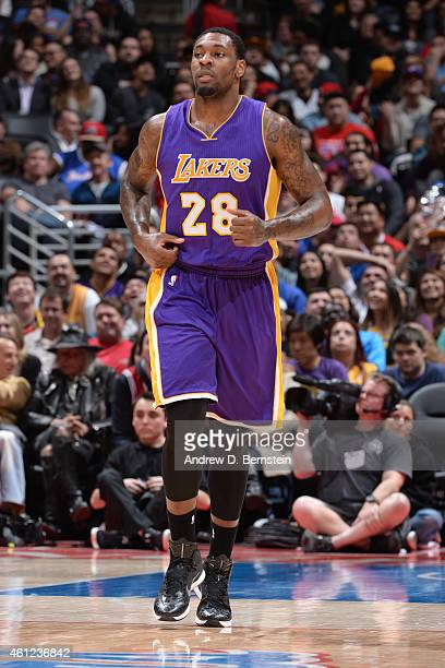 Tarik Black of the Los Angeles Lakers runs up court against the Los Angeles Clippers at STAPLES Center on January 07 2015 in Los Angeles California...