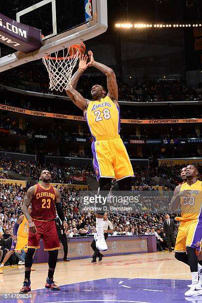 Tarik Black of the Los Angeles Lakers shoots the ball against the Cleveland Cavaliers on March 10 2016 at STAPLES Center in Los Angeles California...
