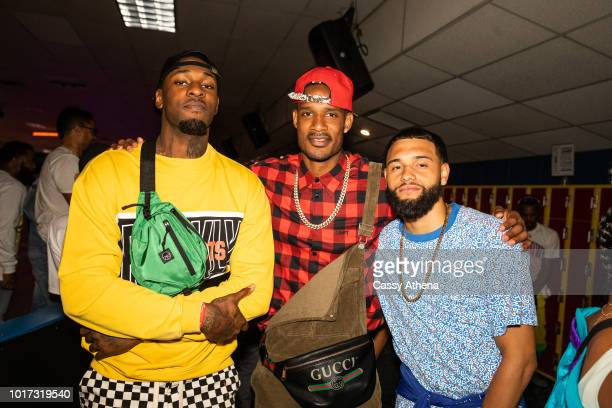 Tarik Black Trevor Ariza and Tyler Ennis attend the 7th Annual 90's Skate Night Fundraiser hosted by Delon Dorell and Mia Wright at Skateland on...