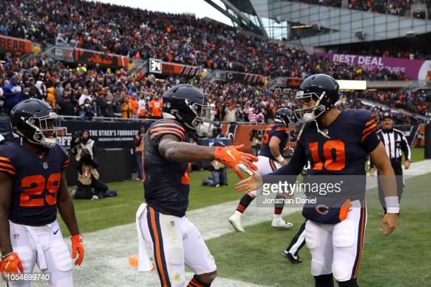 Tarik Cohen Anthony Miller and quarterback Mitchell Trubisky of the Chicago Bears celebrate after Miller scored a touchdown in the third quarter...