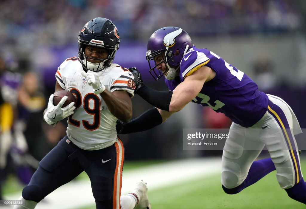 Tarik Cohen #29 of the Chicago Bears breaks a tackle by Harrison Smith #22 of the Minnesota Vikings in the fourth quarter of the game on December 31, 2017 at U.S. Bank Stadium in Minneapolis, Minnesota.