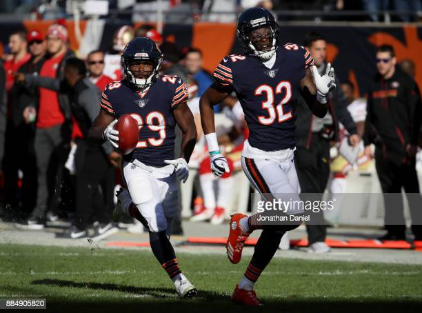 Tarik Cohen of the Chicago Bears carries a punt return toward the endzone next to Deiondre' Hall resulting in a touchdown in the second quarter...