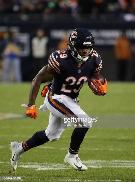 Tarik Cohen of the Chicago Bears carries the ball against the Philadelphia Eagles in the first half of the NFC Wild Card Playoff game at Soldier...