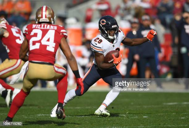 Tarik Cohen of the Chicago Bears carries the ball against the San Francisco 49ers during the first half of an NFL football game at Levi's Stadium on...