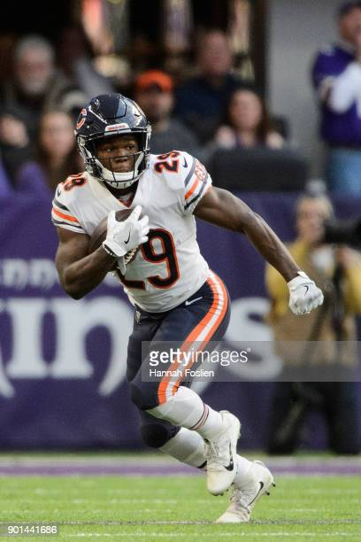 Tarik Cohen of the Chicago Bears carries the ball against the Minnesota Vikings during the game on December 31 2017 at US Bank Stadium in Minneapolis...
