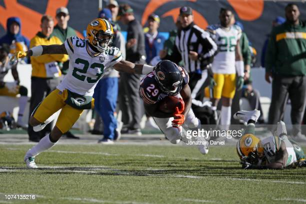 Tarik Cohen of the Chicago Bears carries the football against Jaire Alexander of the Green Bay Packers in the second quarter at Soldier Field on...