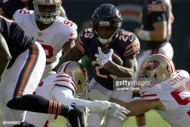Tarik Cohen of the Chicago Bears carries the football against the San Francisco 49ers in the first quarter at Soldier Field on December 3 2017 in...
