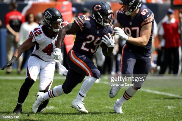 Tarik Cohen of the Chicago Bears carries the football ahead of Duke Riley of the Atlanta Falcons in the second quarter at Soldier Field on September...