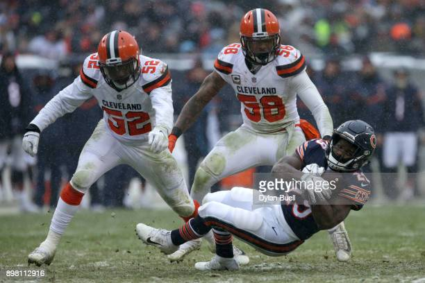 Tarik Cohen of the Chicago Bears catches the football in front of Christian Kirksey of the Cleveland Browns in the third quarter at Soldier Field on...