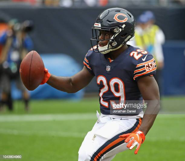 Tarik Cohen of the Chicago Bears celebrates a touchdown run against the Tampa Bay Buccaneers at Soldier Field on September 30 2018 in Chicago...