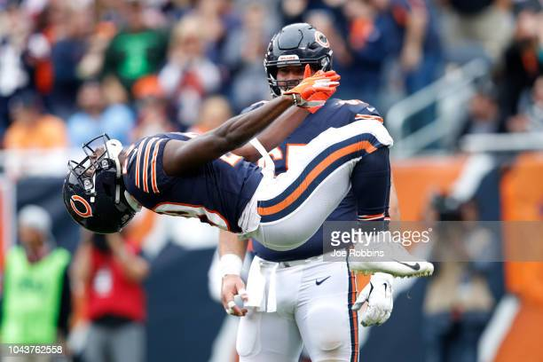 Tarik Cohen of the Chicago Bears celebrates a touchdown with a backflip in the second quarter against the Tampa Bay Buccaneers at Soldier Field on...