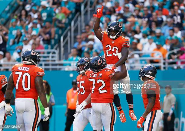Tarik Cohen of the Chicago Bears celebrates a touchdown with teammates in the third quarter against the Miami Dolphins at Hard Rock Stadium on...
